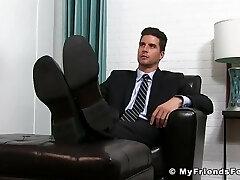 Elegant jock in suit enjoying is some sloppy feet sucking