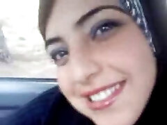Hot arab demonstrating her melons in the car