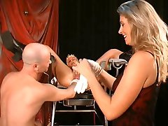 First she's fisted, then her labia gets pierced!