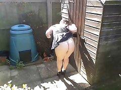 Slutty maid in the garden