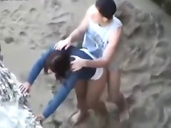 Teens doggy style on the beach