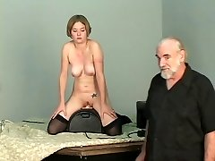 Short-haired b-cup blonde lowers her vagina onto mechanical faux-cock