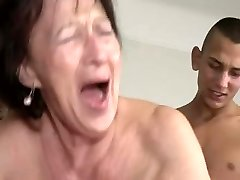 Granny Enjoys Young Boy's Balls and Ass