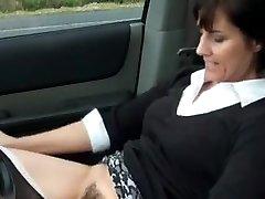 Sexy cougar masturbates in car