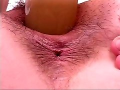 Horny bitch riding dildo like a pecker at gym