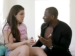 Black dude likes the way Kimber Woods is riding his stiff dick in his bed