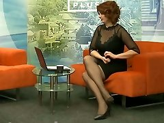 Long legs in black pantyhose and high-heeled shoes on TV 0
