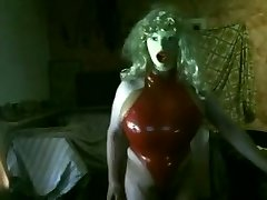 Huge fake Boobs in red rubber Assets string