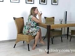 Nara Abel wanks on her kitchen table