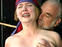Adorable young blonde with perky tits is restrained for nipple pin play