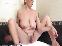 Tattooed mature housewife playing