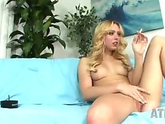 Blonde bombshell Lucy smoking and playing with her pussy