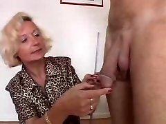 Italian Granny enjoys 2 cocks