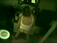 Covert cam caught milf frigging in front of mirror