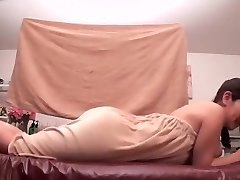 Oiled Asian darling prefers getting massaged by her acquaintance
