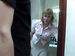 Mature mom takes a piss on the toilet and gets interrupted by her son for a fuck