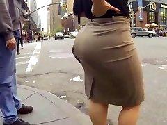 Candide gros cul en marchant dans travail très robe