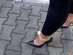 Walking with high-heeled shoes full of cum
