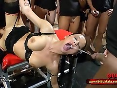 Filthy brunette whore used as a toilet in a huge gang-fuck