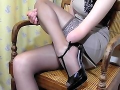 Hand Amputee putting on Stockings