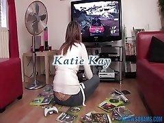 British slut masturbates with movie game controllers