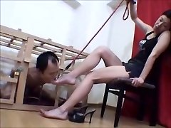 Caged Japanese foot slave worships her mistress