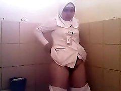 Arab woman heads pee in a public toilet