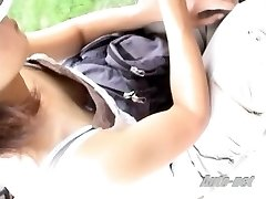 Gal in baseball cap with sweet puffies in the downblouse scene