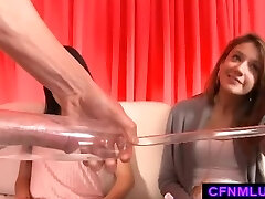 Girls measure beef whistle in penis pump during CFNM show
