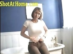 Blonde mom is posing and rubbing her pussy on homemade video