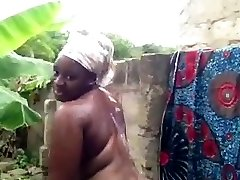 african chick takes a shower