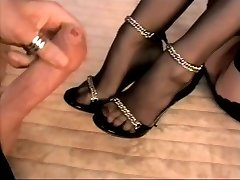 Stocking footjob with jizm on feet and stilettos