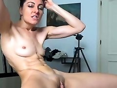 Brunette solo masturbation on the bed