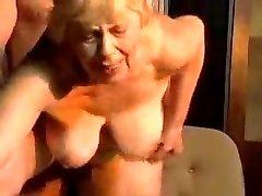 Platinum-blonde chubby grandma.