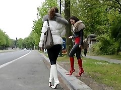 prostitute waiting a john in designer patent leather boots