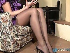 Nasty brunette sweetie Flavia looks irresistible in black nylon stockings