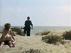 Spycam Man wanking and fuck redhead girl on a public beach