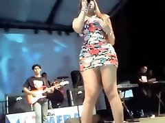 Upskirt of a lady singing on the stage
