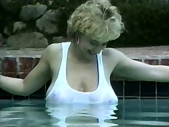 Huge-chested blonde in a pool