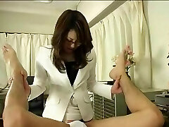 Japanese Doctor In Glasses Uses Cord on