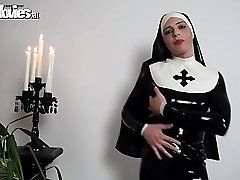 Slutty latex nun petting her kinky latex costume