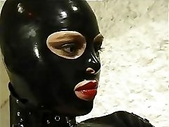 Warm cat gal in leather suit does anything she wants to her horny slave