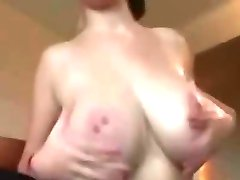 Very busty brunette enjoying oral sex