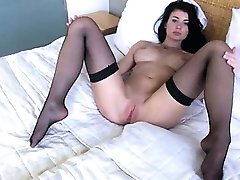 Brunette pornstar opening gaped snatch