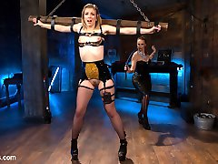 Latex dominatrix Bella Rossi uses tough slut Ella Nova for her sadistic pleasure! Ella enjoys bondage, whipping, electrified butt plug, wired dildo, electrified butt toy, pussy licking, and lesbian strap-on fucking!
