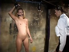Young lezzy with tiny titties loves to play bdsm dungeon games with domme