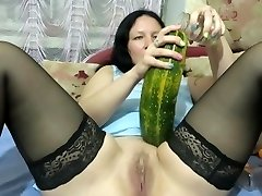 milf pokes herself with a bottle, zucchini and makes fisting. bust