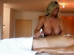 Busty MILF Gives Oil Massage And Hj