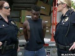 Caucasian police ladies fucks ebony scofflaw in threesome