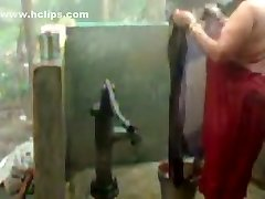 large beautiful woman indian bhabhi taking shower from pump